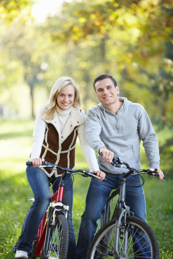couple on bikes smiling