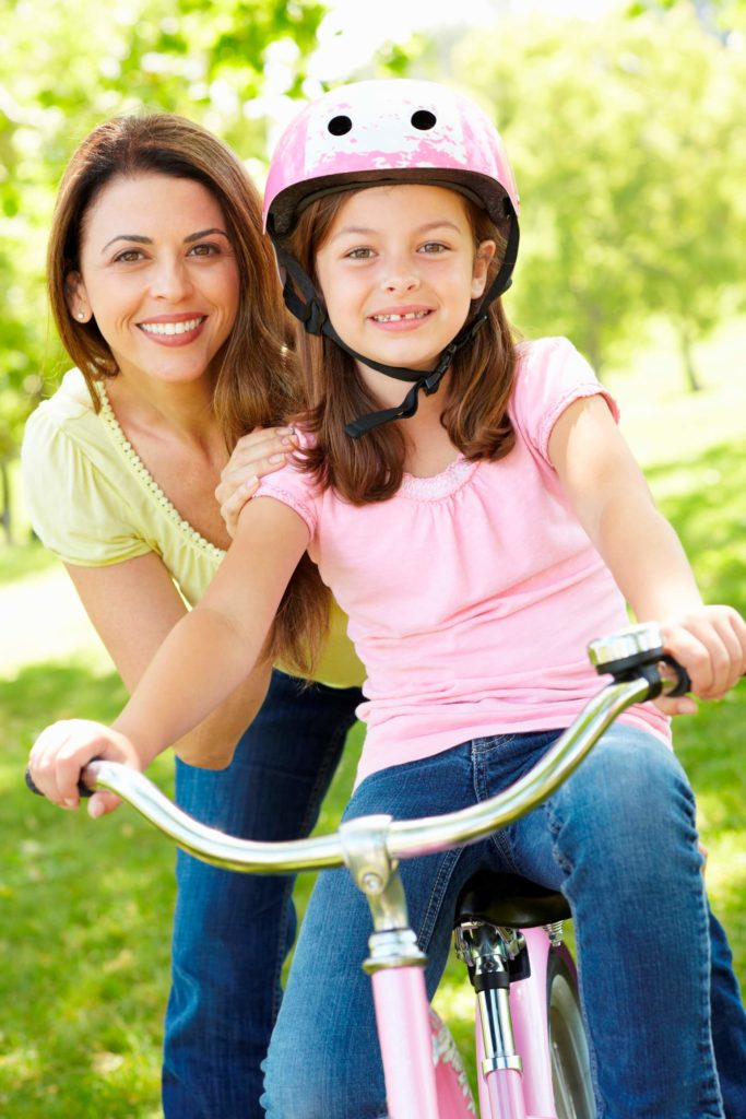 mom with daughter riding bike