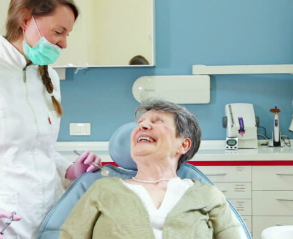Dentist seeing a senior woman
