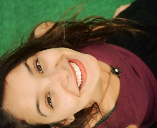 Brunette Adolescent Female Smiling with Beautiful Teeth