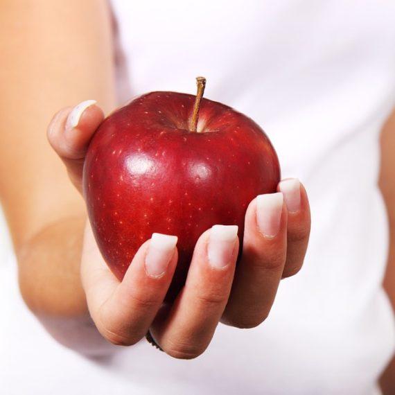 Apple in woman's hand.